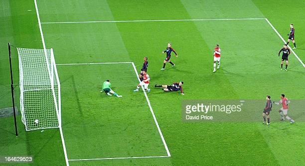 Serge Gnabry scores Arsenal's goal past Sergey Revyakin of CSKA during the NextGen Series Quarter Final match between Arsenal and PFC CSKA at...