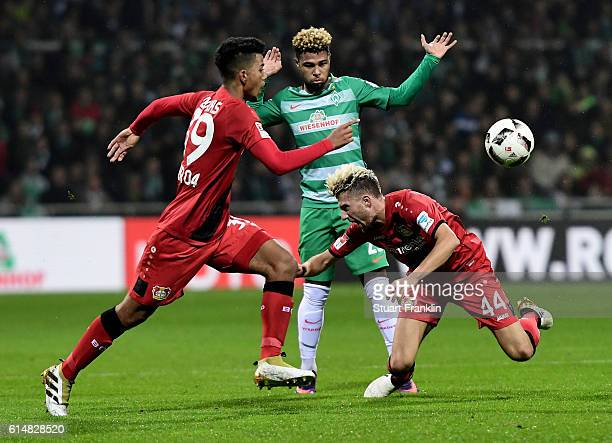 Serge Grabny of Bremen and Kevin Kampl of Leverkusen battle for the ball during the Bundesliga match between Werder Bremen and Bayer 04 Leverkusen at...