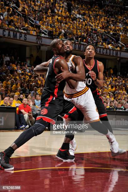Serge Ibaka and DeMar DeRozan of the Toronto Raptors box out Tristan Thompson of the Cleveland Cavaliers during Game One of the Eastern Conference...