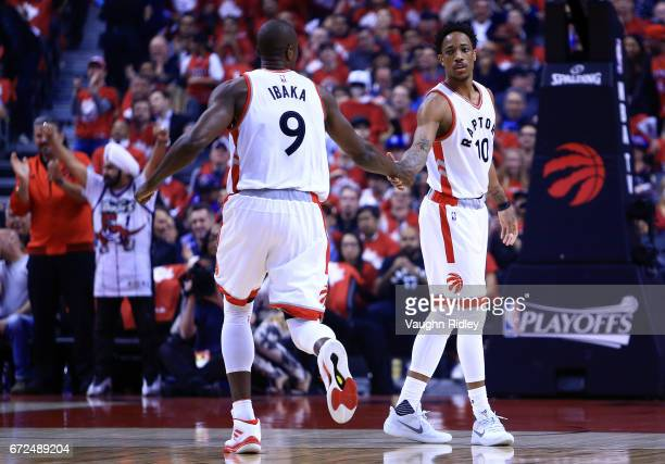 Serge Ibaka and DeMar DerRozan of the Toronto Raptors slap hands in the first half of Game Five of the Eastern Conference Quarterfinals against the...