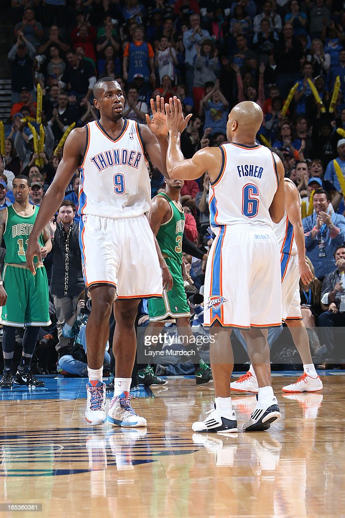 Serge Ibaka #9 and Derek Fisher #6 of the Oklahoma City Thunder celebrate a shot against the Boston Celtics on March 10, 2013 at the Chesapeake Energy Arena in Oklahoma City, Oklahoma.