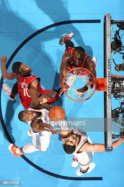 Serge Ibaka and Enes Kanter of the Oklahoma City Thunder reach for the rebound against the Toronto Raptors during the game on November 4 2015 at...