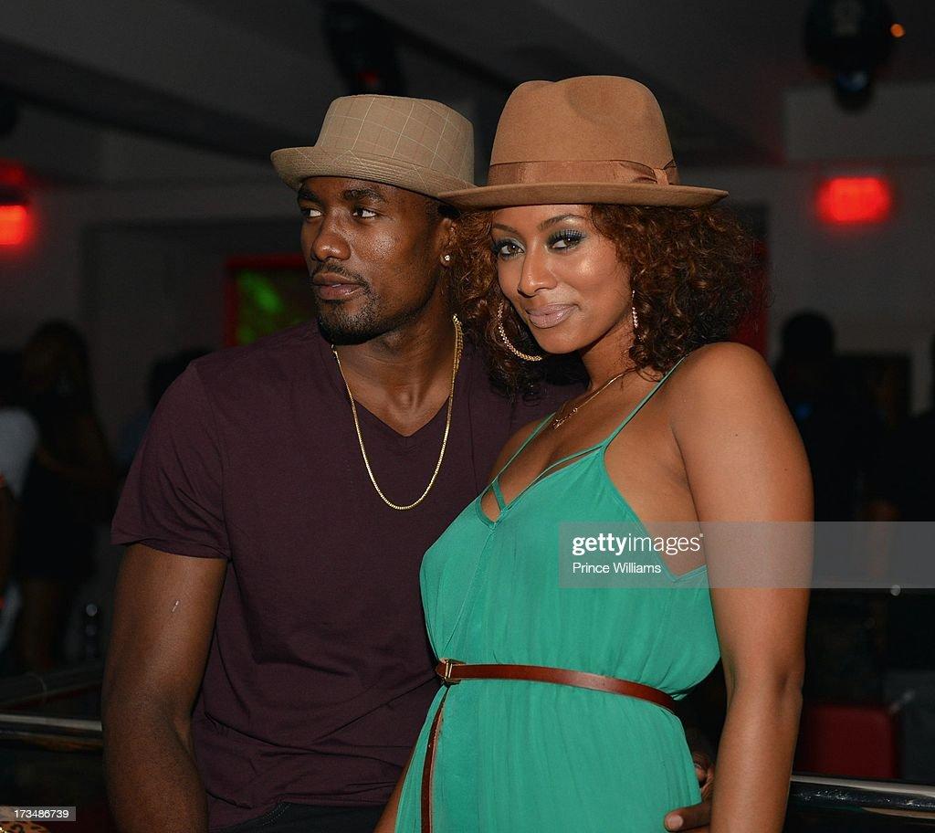 Serge Ibaka and Keri Hilson attend compound Nightclub on July 13 2013 in Atlanta Georgia