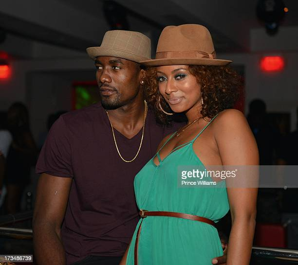 Serge Ibaka and Keri Hilson attend compound Nightclub on July 13 2013 in Atlanta Georgia