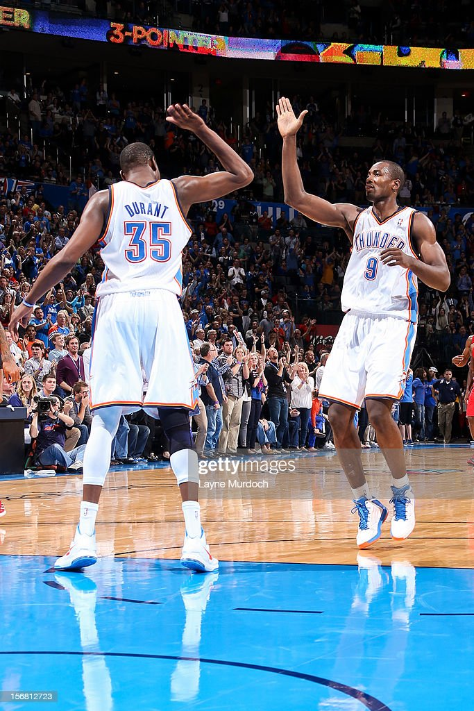 Serge Ibaka #9 and Kevin Durant #35 of the Oklahoma City Thunder celebrate while playing the Los Angeles Clippers on November 21, 2012 at the Chesapeake Energy Arena in Oklahoma City, Oklahoma.