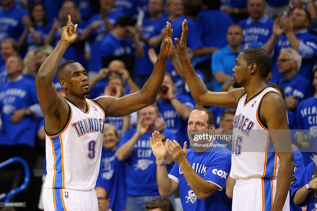 Serge Ibaka and Kevin Durant of the Oklahoma City Thunder celebrate late in the second half against the San Antonio Spurs during Game Three of the...