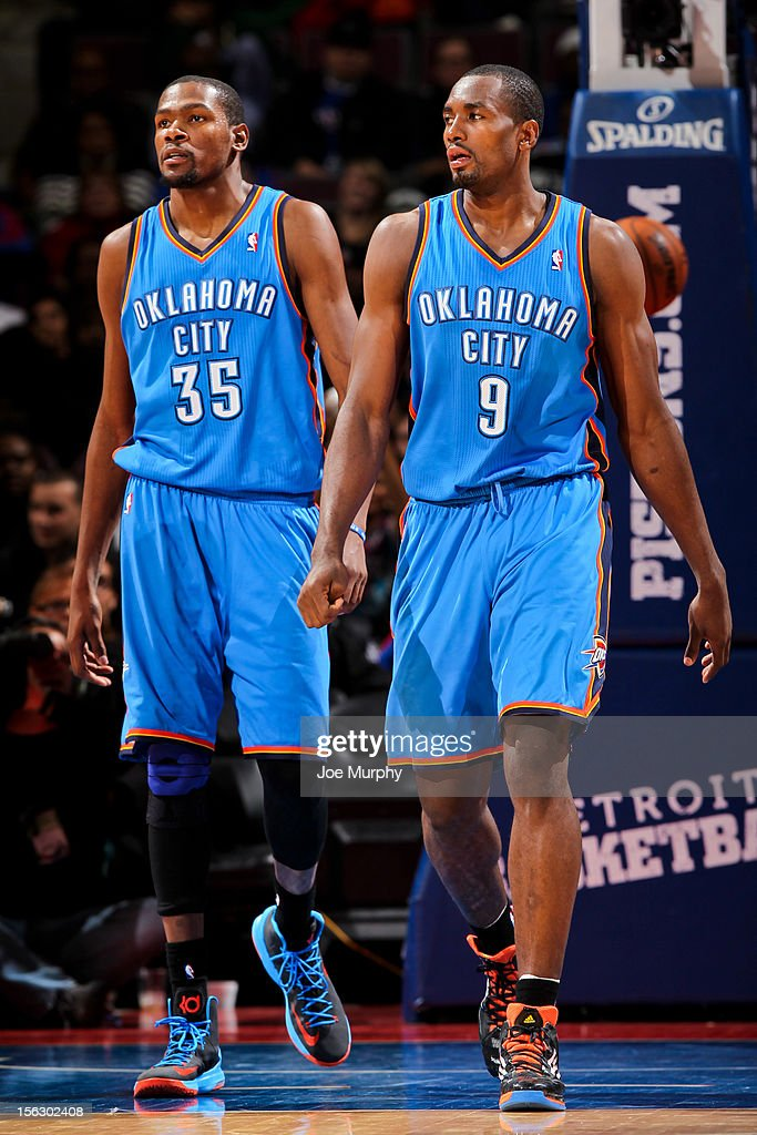 <a gi-track='captionPersonalityLinkClicked' href=/galleries/search?phrase=Serge+Ibaka&family=editorial&specificpeople=5133378 ng-click='$event.stopPropagation()'>Serge Ibaka</a> #9 and <a gi-track='captionPersonalityLinkClicked' href=/galleries/search?phrase=Kevin+Durant&family=editorial&specificpeople=3847329 ng-click='$event.stopPropagation()'>Kevin Durant</a> #35 of the Oklahoma City Thunder wait to resume action against the Detroit Pistons on November 12, 2012 at The Palace of Auburn Hills in Auburn Hills, Michigan.