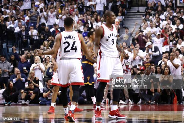 Serge Ibaka and Norman Powell of the Toronto Raptors high five each other during the game against the Cleveland Cavaliers in Game Four of the Eastern...