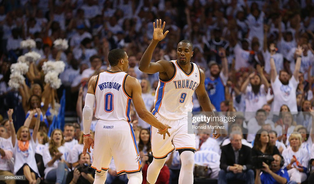 Serge Ibaka and Russell Westbrook of the Oklahoma City Thunder celebrate after a play against the San Antonio Spurs in the first half during Game Six...