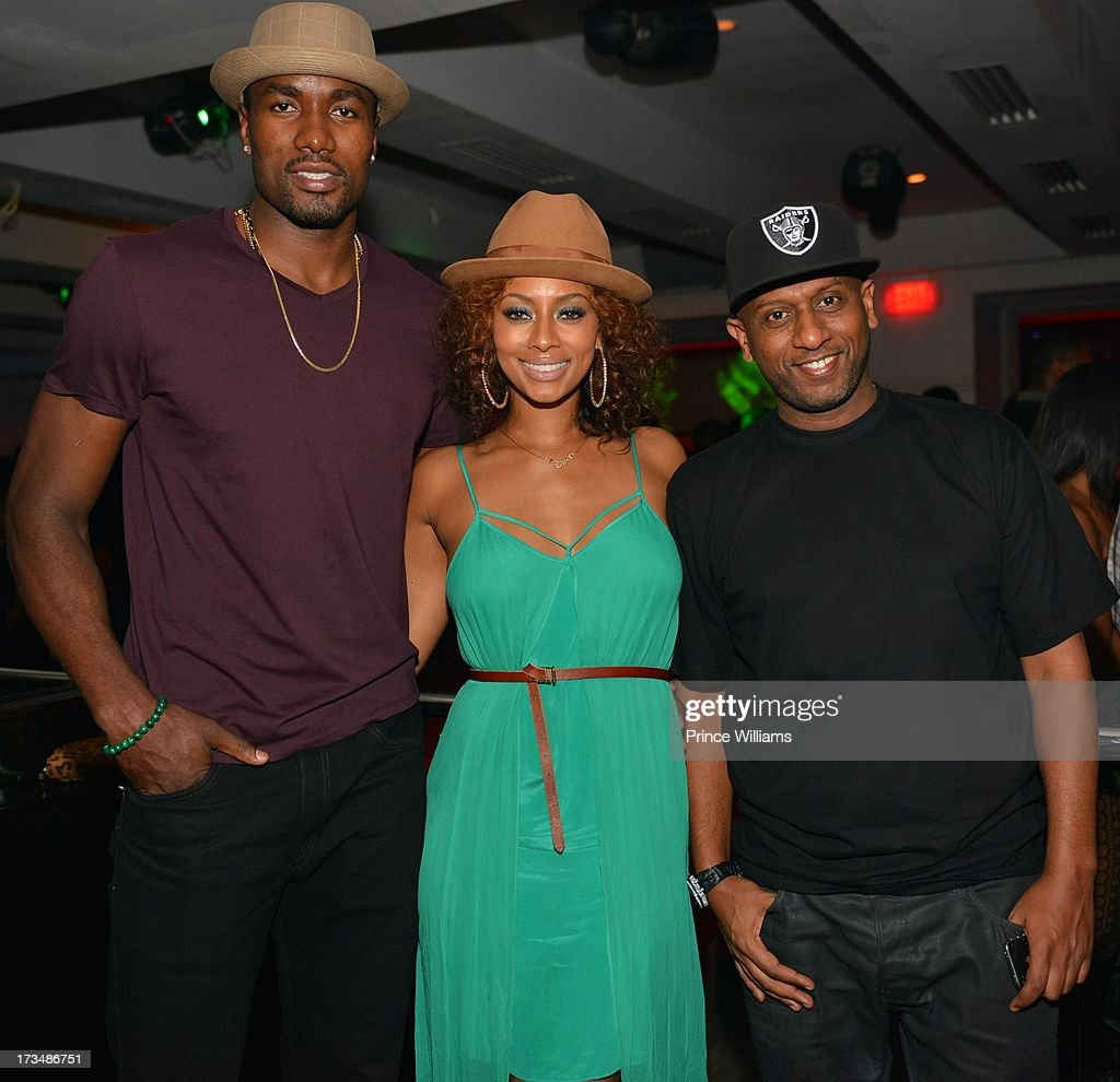 Serge Ibaka, Keri Hilson and Alex Gidewon attend compound Nightclub on July 13, 2013 in Atlanta, Georgia.