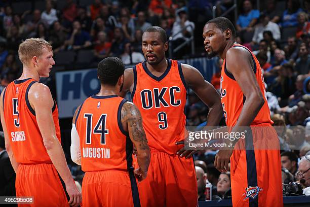 Serge Ibaka Kevin Durant Kyle Singler and DJ Augustin of the Oklahoma City Thunder huddle during the game against the Denver Nuggets on November 1...