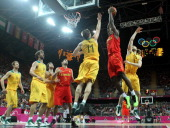 Serge Ibaka of Spain goes up against Mark Worthington of Australia in the Men's Basketball Preliminary Round match between Australia and Spain on Day...