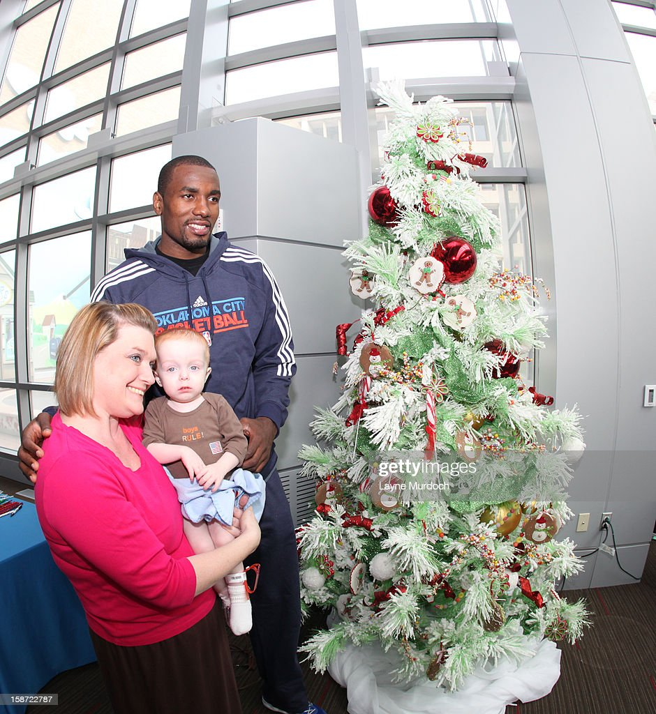 Serge Ibaka #9 of the Oklahoma City Thunder along with the rest of the team, visits patients in the Children's Hospital on December 22, 2012 in Oklahoma City, Oklahoma.