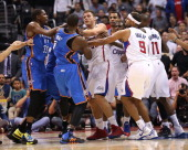 Serge Ibaka of the Oklahoma City Thunder and Blake Griffin of the Los Angeles Clippers are at the center of an altercation during the game at Staples...