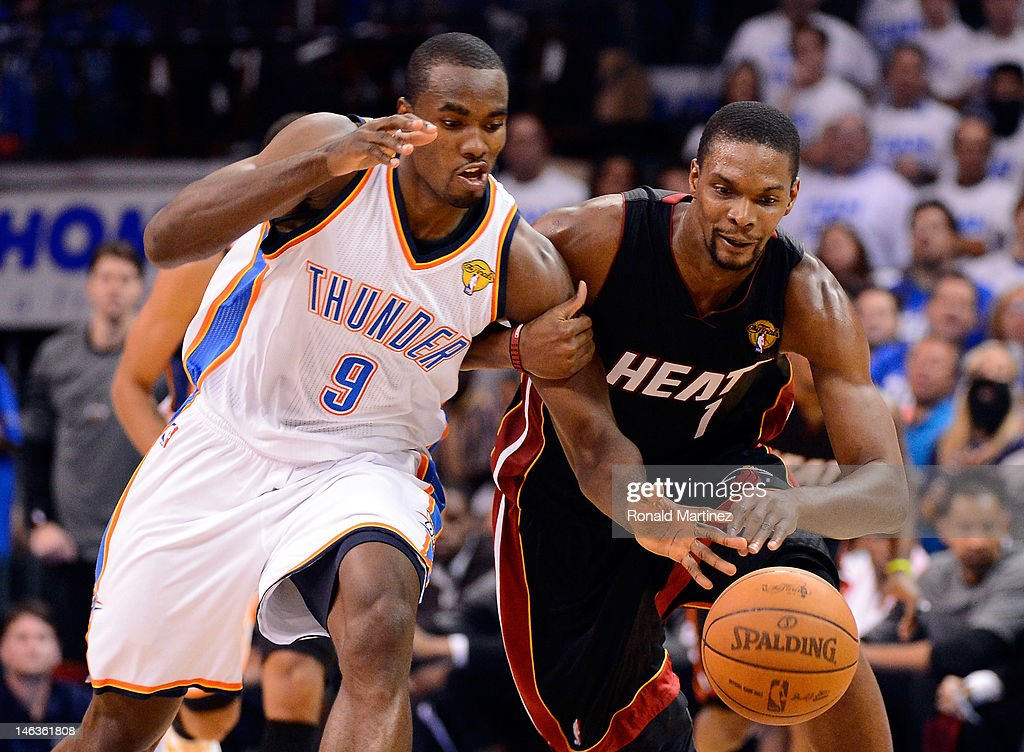 Serge Ibaka of the Oklahoma City Thunder and Chris Bosh of the Miami Heat go after a loose ball in the second quarter in Game Two of the 2012 NBA...