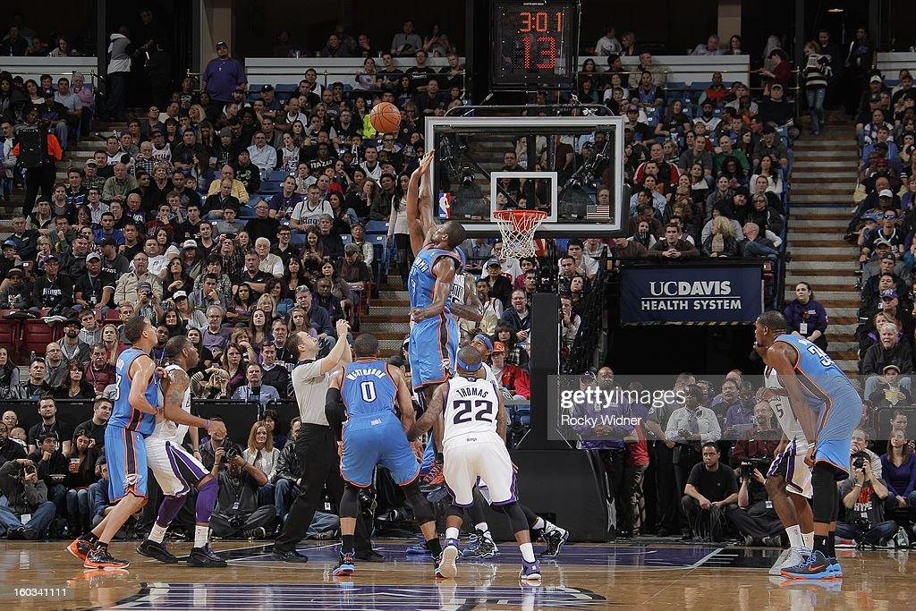 Serge Ibaka #9 of the Oklahoma City Thunder and John Salmons #5 of the Sacramento Kings go after the jump ball on January 25, 2013 at Sleep Train Arena in Sacramento, California.