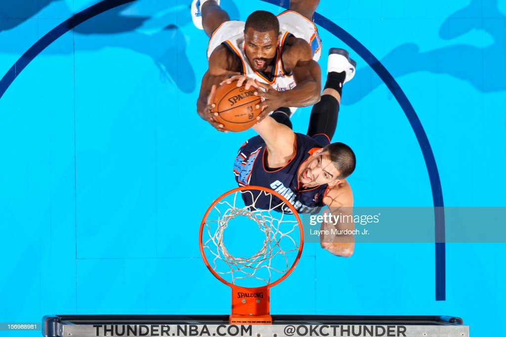 <a gi-track='captionPersonalityLinkClicked' href=/galleries/search?phrase=Serge+Ibaka&family=editorial&specificpeople=5133378 ng-click='$event.stopPropagation()'>Serge Ibaka</a> #9 of the Oklahoma City Thunder battles for a rebound against Byron Mullens #22 of the Charlotte Bobcats on November 26, 2012 at the Chesapeake Energy Arena in Oklahoma City, Oklahoma.
