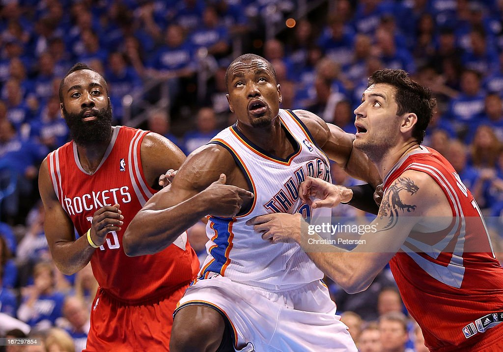 Serge Ibaka #9 of the Oklahoma City Thunder battles James Harden #13 and Carlos Delfino #10 of the Houston Rockets for position during Game One of the Western Conference Quarterfinals of the 2013 NBA Playoffs at Chesapeake Energy Arena on April 21, 2013 in Oklahoma City, Oklahoma. The Thunder defeated the Rockets 120-91.