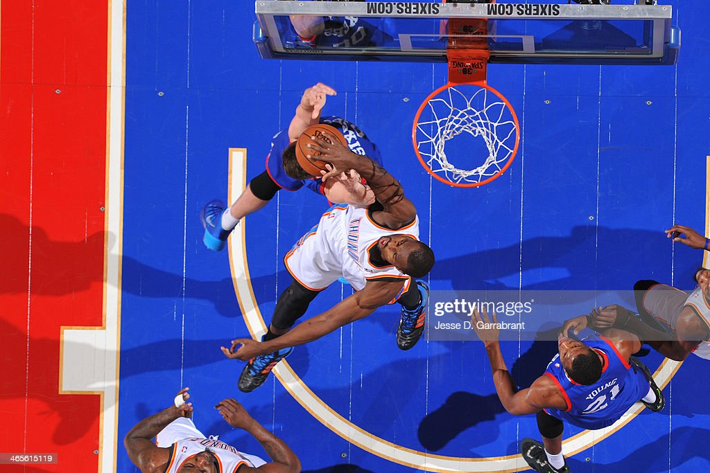 <a gi-track='captionPersonalityLinkClicked' href=/galleries/search?phrase=Serge+Ibaka&family=editorial&specificpeople=5133378 ng-click='$event.stopPropagation()'>Serge Ibaka</a> #9 of the Oklahoma City Thunder blocks a shot against the Philadelphia 76ers at the Wells Fargo Center on January 25, 2014 in Philadelphia, Pennsylvania.