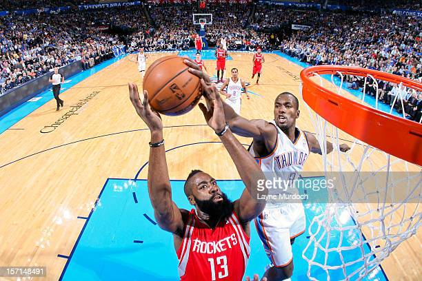 Serge Ibaka of the Oklahoma City Thunder blocks a shot attempt by James Harden of the Houston Rockets on November 28 2012 at the Chesapeake Energy...