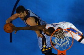 Serge Ibaka of the Oklahoma City Thunder blocks a shot by Marc Gasol of the Memphis Grizzlies in Game Seven of the Western Conference Quarterfinals...