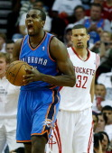 Serge Ibaka of the Oklahoma City Thunder celebrates a play against Francisco Garcia of the Houston Rockets in Game Three of the Western Conference...
