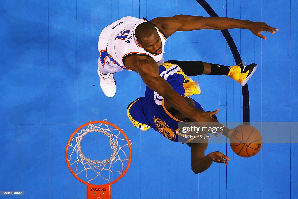 Serge Ibaka of the Oklahoma City Thunder defends a shot by Draymond Green of the Golden State Warriors during the first half in game six of the...