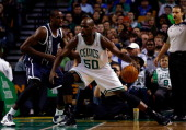 Serge Ibaka of the Oklahoma City Thunder defends against Joel Anthony of the Boston Celtics during a game at the TD Garden on January 24 2014 in...