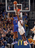 Serge Ibaka of the Oklahoma City Thunder defends Amar'e Stoudemire of the New York Knicks on January 22 2011 at the Ford Center in Oklahoma City...