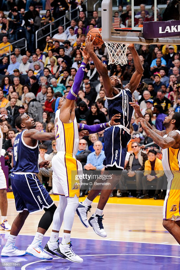 Serge Ibaka #9 of the Oklahoma City Thunder drives to the basket against Dwight Howard #12 of the Los Angeles Lakers at Staples Center on January 27, 2013 in Los Angeles, California.