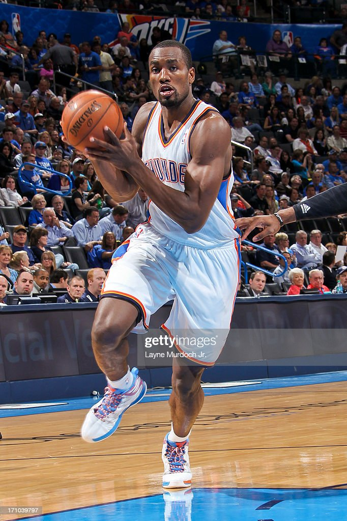 <a gi-track='captionPersonalityLinkClicked' href=/galleries/search?phrase=Serge+Ibaka&family=editorial&specificpeople=5133378 ng-click='$event.stopPropagation()'>Serge Ibaka</a> #9 of the Oklahoma City Thunder drives to the basket against the Sacramento Kings on April 15, 2013 at the Chesapeake Energy Arena in Oklahoma City, Oklahoma.