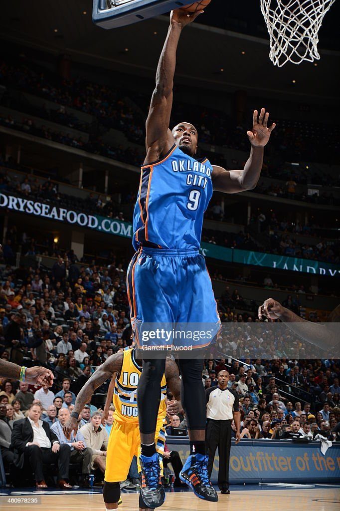 <a gi-track='captionPersonalityLinkClicked' href=/galleries/search?phrase=Serge+Ibaka&family=editorial&specificpeople=5133378 ng-click='$event.stopPropagation()'>Serge Ibaka</a> #9 of the Oklahoma City Thunder drives to the basket against the Denver Nuggets on December 17, 2013 at the Pepsi Center in Denver, Colorado.