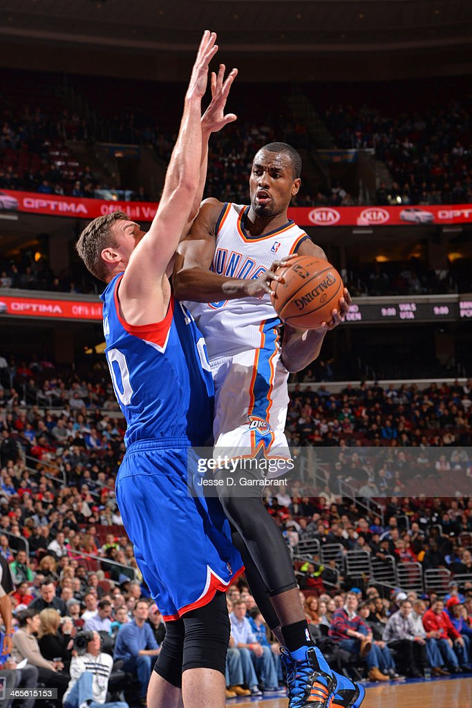 <a gi-track='captionPersonalityLinkClicked' href=/galleries/search?phrase=Serge+Ibaka&family=editorial&specificpeople=5133378 ng-click='$event.stopPropagation()'>Serge Ibaka</a> #9 of the Oklahoma City Thunder drives to the basket against the Philadelphia 76ers at the Wells Fargo Center on January 25, 2014 in Philadelphia, Pennsylvania.