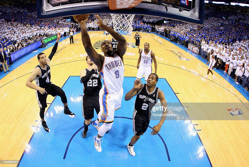 Serge Ibaka #9 of the Oklahoma City Thunder drives to the basket against Kawhi Leonard #2 of the San Antonio Spurs in the first half during Game Four of the Western Conference Finals of the 2014 NBA Playoffs at Chesapeake Energy Arena on May 27, 2014 in Oklahoma City, Oklahoma.