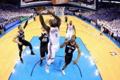 Serge Ibaka of the Oklahoma City Thunder drives to the basket against Kawhi Leonard of the San Antonio Spurs in the first half during Game Four of...