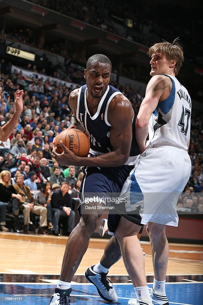 <a gi-track='captionPersonalityLinkClicked' href=/galleries/search?phrase=Serge+Ibaka&family=editorial&specificpeople=5133378 ng-click='$event.stopPropagation()'>Serge Ibaka</a> #9 of the Oklahoma City Thunder drives to the basket around <a gi-track='captionPersonalityLinkClicked' href=/galleries/search?phrase=Andrei+Kirilenko&family=editorial&specificpeople=201909 ng-click='$event.stopPropagation()'>Andrei Kirilenko</a> #47 of the Minnesota Timberwolves on December 20, 2012 at Target Center in Minneapolis, Minnesota.
