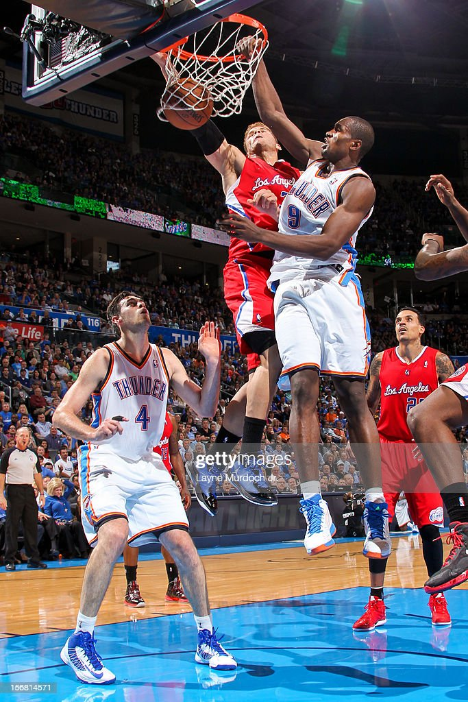 Serge Ibaka #9 of the Oklahoma City Thunder dunks against Blake Griffin #32 of the Los Angeles Clippers on November 21, 2012 at the Chesapeake Energy Arena in Oklahoma City, Oklahoma.