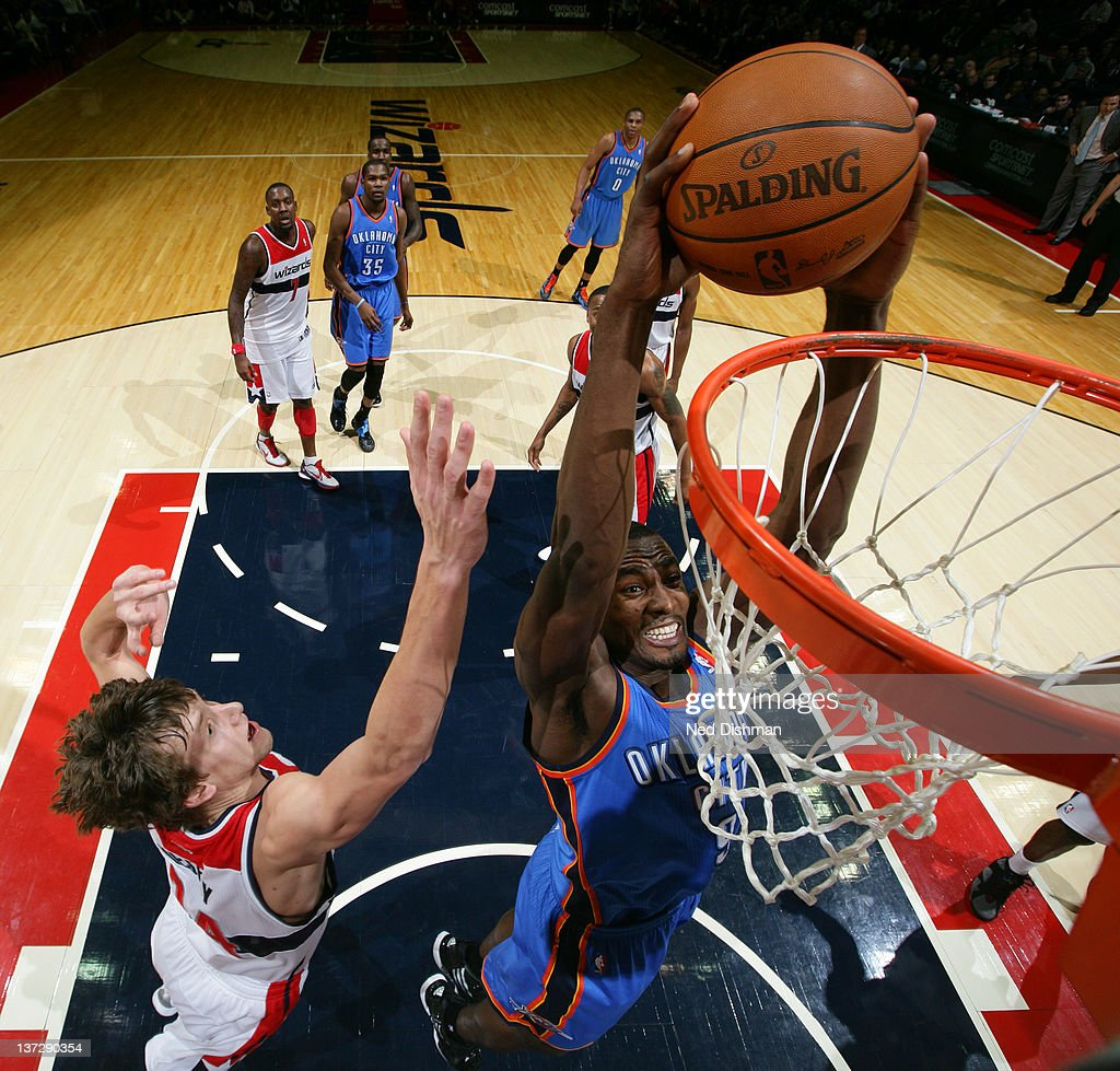 <a gi-track='captionPersonalityLinkClicked' href=/galleries/search?phrase=Serge+Ibaka&family=editorial&specificpeople=5133378 ng-click='$event.stopPropagation()'>Serge Ibaka</a> #9 of the Oklahoma City Thunder dunks against <a gi-track='captionPersonalityLinkClicked' href=/galleries/search?phrase=Jan+Vesely&family=editorial&specificpeople=5620499 ng-click='$event.stopPropagation()'>Jan Vesely</a> #24 of the Washington Wizards during the game at the Verizon Center on January 18, 2012 in Washington, DC.