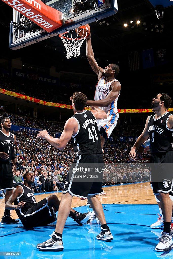 Serge Ibaka #9 of the Oklahoma City Thunder dunks against Kris Humphries #43 of the Brooklyn Nets on January 2, 2013 at the Chesapeake Energy Arena in Oklahoma City, Oklahoma.