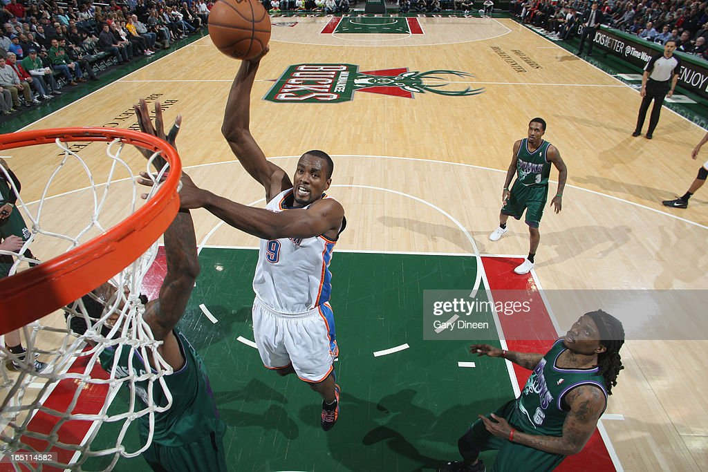 Serge Ibaka #9 of the Oklahoma City Thunder dunks against Larry Sanders #8 of the Milwaukee Bucks on March 30, 2013 at the BMO Harris Bradley Center in Milwaukee, Wisconsin.