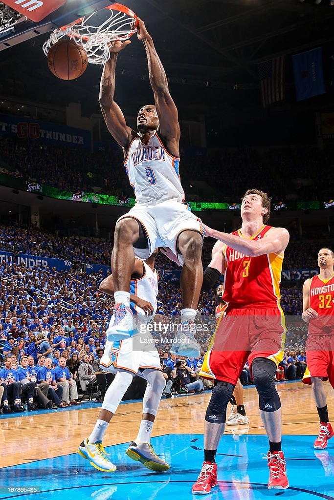 Serge Ibaka #9 of the Oklahoma City Thunder dunks against Omer Asik #3 of the Houston Rockets in Game Five of the Western Conference Quarterfinals during the 2013 NBA Playoffs on May 1, 2013 at the Chesapeake Energy Arena in Oklahoma City, Oklahoma.