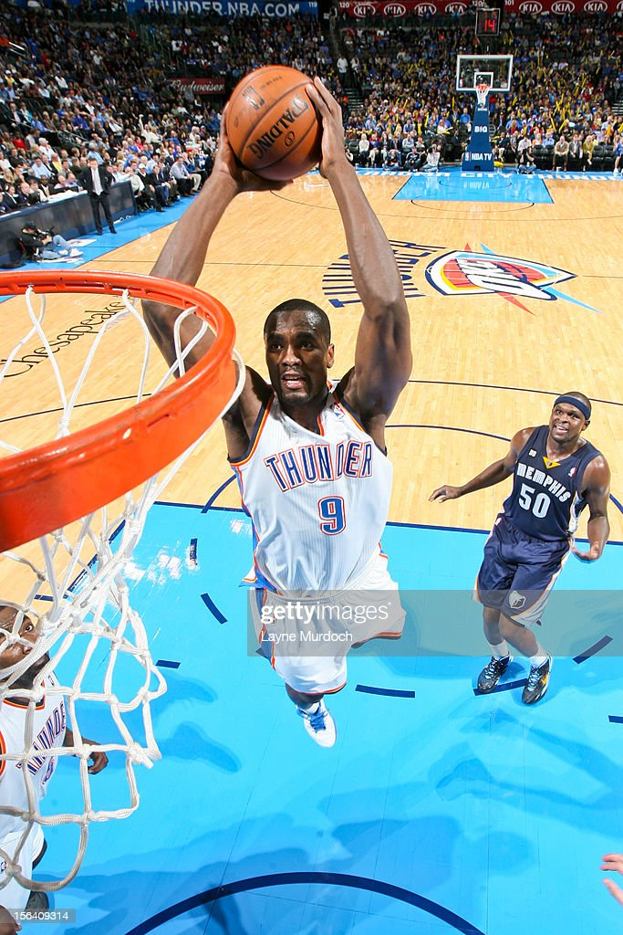 <a gi-track='captionPersonalityLinkClicked' href=/galleries/search?phrase=Serge+Ibaka&family=editorial&specificpeople=5133378 ng-click='$event.stopPropagation()'>Serge Ibaka</a> #9 of the Oklahoma City Thunder dunks against the Memphis Grizzlies on November 14, 2012 at the Chesapeake Energy Arena in Oklahoma City, Oklahoma.