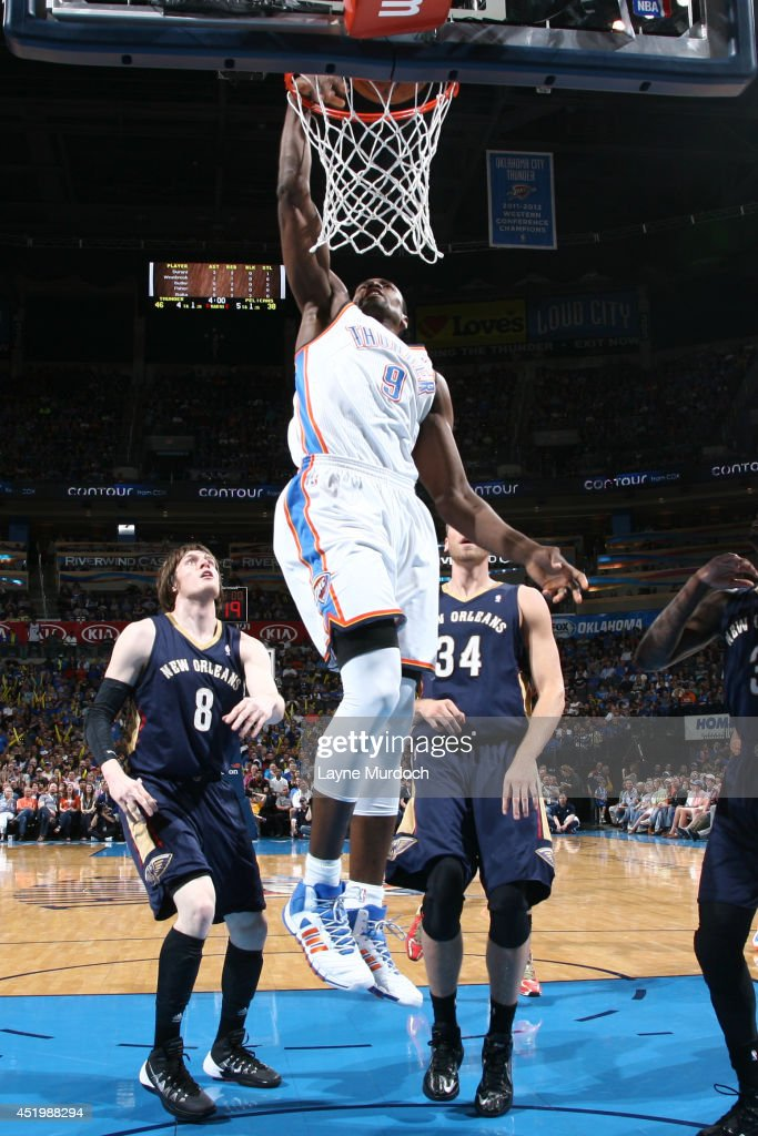 <a gi-track='captionPersonalityLinkClicked' href=/galleries/search?phrase=Serge+Ibaka&family=editorial&specificpeople=5133378 ng-click='$event.stopPropagation()'>Serge Ibaka</a> #9 of the Oklahoma City Thunder dunks against the New Orleans Pelicans on April 11, 2014 at the Chesapeake Energy Arena in Oklahoma City, Oklahoma.