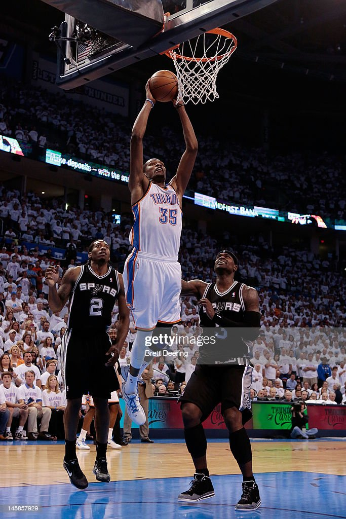 <a gi-track='captionPersonalityLinkClicked' href=/galleries/search?phrase=Serge+Ibaka&family=editorial&specificpeople=5133378 ng-click='$event.stopPropagation()'>Serge Ibaka</a> #9 of the Oklahoma City Thunder dunks the ball against <a gi-track='captionPersonalityLinkClicked' href=/galleries/search?phrase=Kawhi+Leonard&family=editorial&specificpeople=6691012 ng-click='$event.stopPropagation()'>Kawhi Leonard</a> #2 and Stephen Jackson #3 of the San Antonio Spurs in Game Six of the Western Conference Finals of the 2012 NBA Playoffs at Chesapeake Energy Arena on June 6, 2012 in Oklahoma City, Oklahoma.