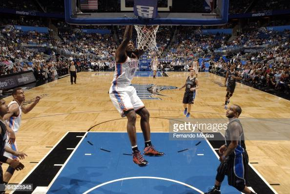 Serge Ibaka of the Oklahoma City Thunder dunks the ball against the Orlando Magic during the game on March 22 2013 at Amway Center in Orlando Florida...