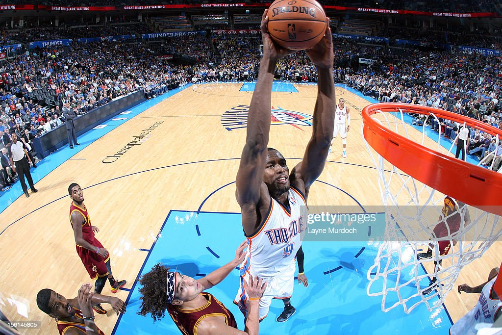 <a gi-track='captionPersonalityLinkClicked' href=/galleries/search?phrase=Serge+Ibaka&family=editorial&specificpeople=5133378 ng-click='$event.stopPropagation()'>Serge Ibaka</a> #9 of the Oklahoma City Thunder dunks the ball vs the Cleveland Cavaliers during an NBA game on November 11, 2012 at the Chesapeake Energy Arena in Oklahoma City, Oklahoma.