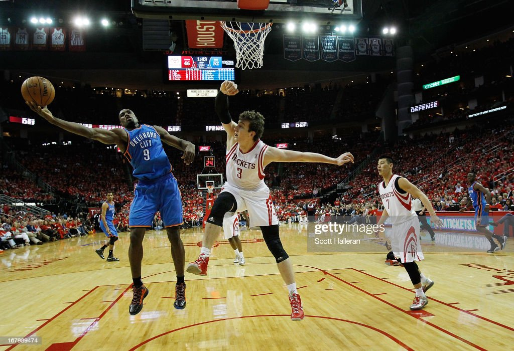 Serge Ibaka #9 of the Oklahoma City Thunder fights for a rebound with Omer Asik #3 of the Houston Rockets in Game Six of the Western Conference Quarterfinals of the 2013 NBA Playoffs at the Toyota Center on May 3, 2013 in Houston, Texas.