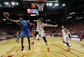 Serge Ibaka of the Oklahoma City Thunder fights for a rebound with Omer Asik of the Houston Rockets in Game Six of the Western Conference...