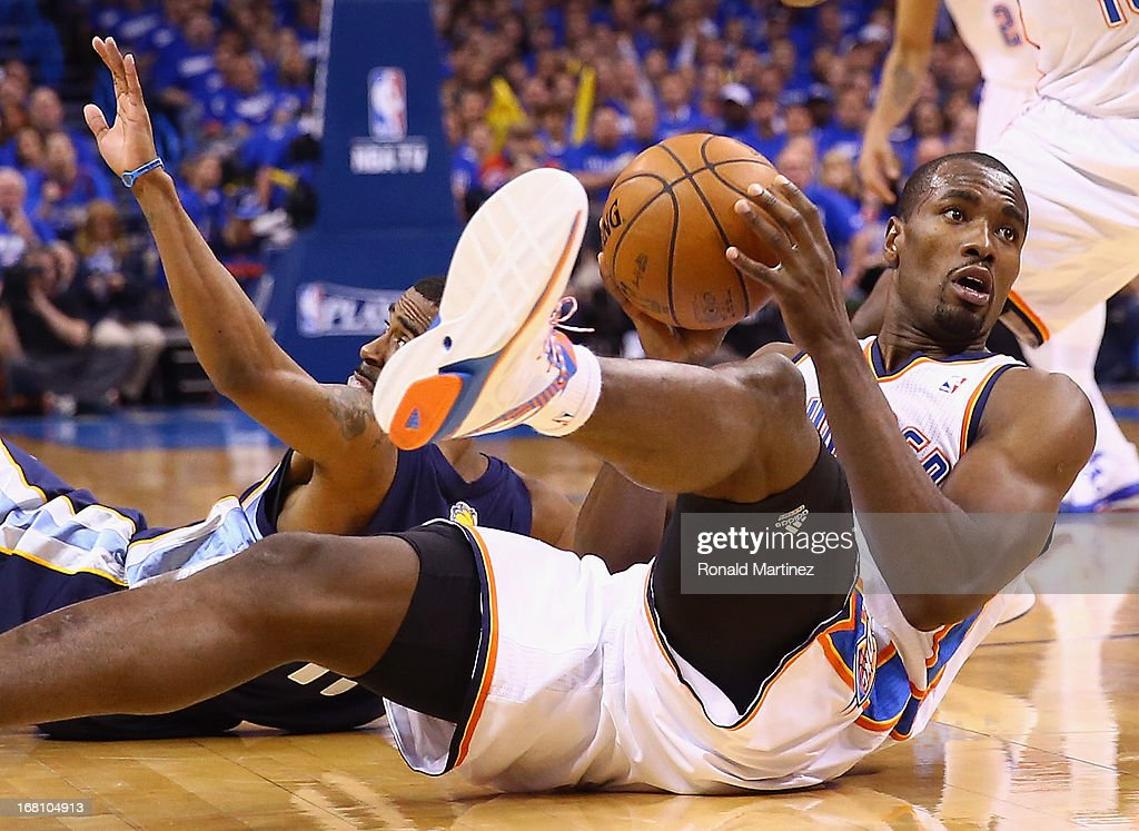 Serge Ibaka #9 of the Oklahoma City Thunder gets a loose ball against Mike Conley #11 of the Memphis Grizzlies during Game One of the Western Conference Semifinals of the 2013 NBA Playoffs at Chesapeake Energy Arena on May 5, 2013 in Oklahoma City, Oklahoma.