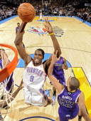 Serge Ibaka of the Oklahoma City Thunder goes to the basket against Francisco Garcia of the Sacramento Kings during the game at the Oklahoma City...